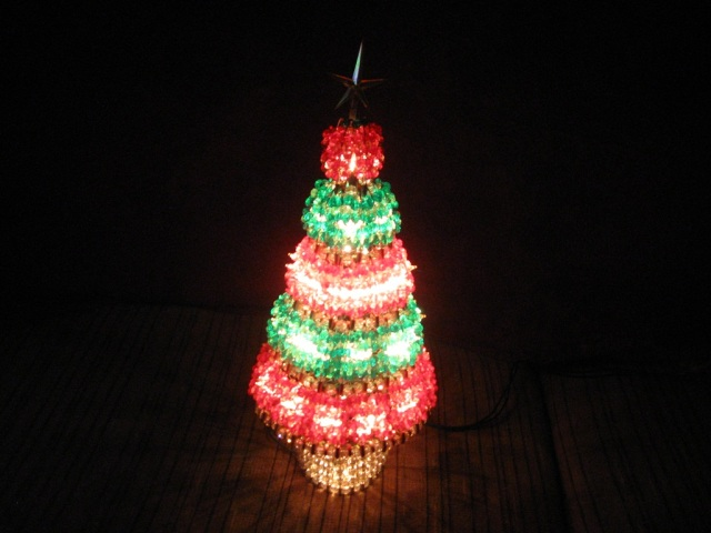 This Christmas Tree was made by my daughter. Its made from differant colored beads with a little string of lights within.